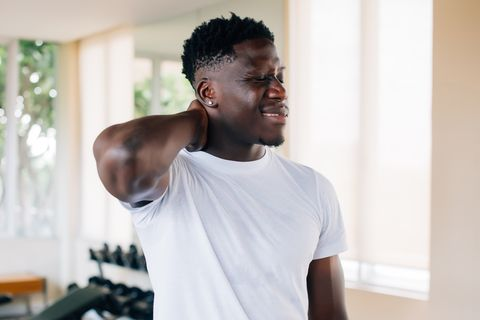 Sportsman suffering from neck pain