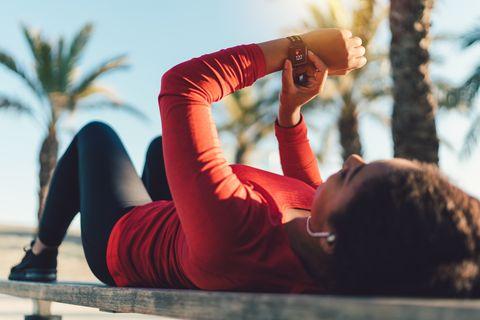 Sportswoman checking pulse on smartwatch
