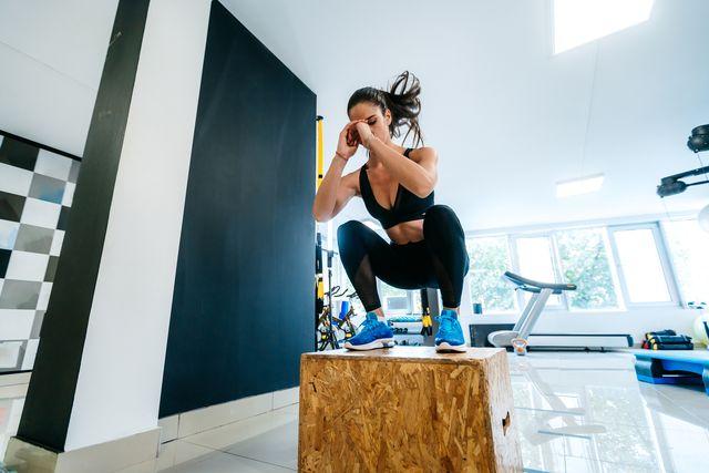 sportswoman doing box squat