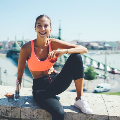 sportswoman jogging in the city