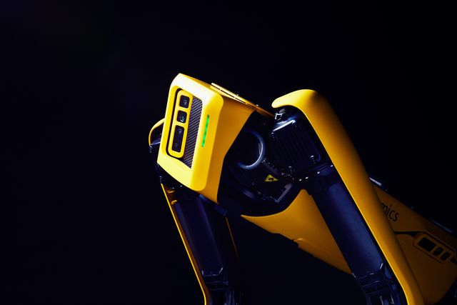 a yellow and black robot dog named spot, from the company boston dynamics
