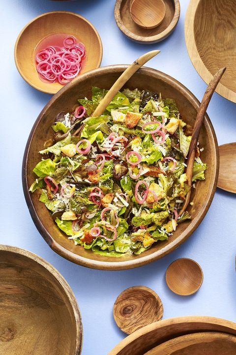spring greens caesar salad with pickled shallot