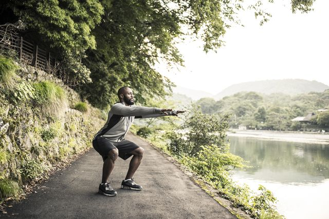 an african american adult man working out in nature