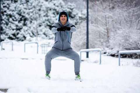 squats in the snowy public park