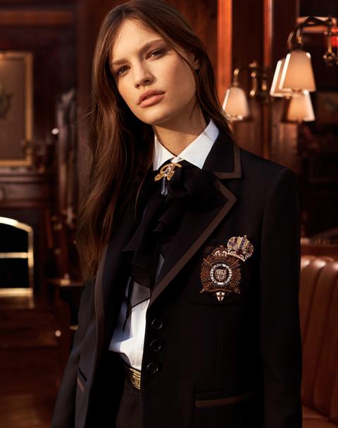 Clothing, Suit, Formal wear, Uniform, Outerwear, Blazer, Collar, Tuxedo, Coat, Sleeve,