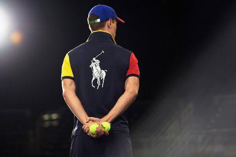 Sports uniform, Jersey, Arm, Sportswear, T-shirt, Elbow, Sports equipment, Uniform, Team sport, Player,