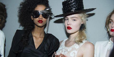 Eyewear, Lip, Hairstyle, Hat, Jheri curl, Style, Fashion accessory, Headgear, Afro, Costume accessory,