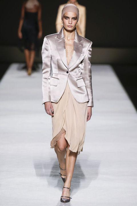 Fashion model, Fashion, Fashion show, Runway, Clothing, Shoulder, Outerwear, Fashion design, Public event, Suit,
