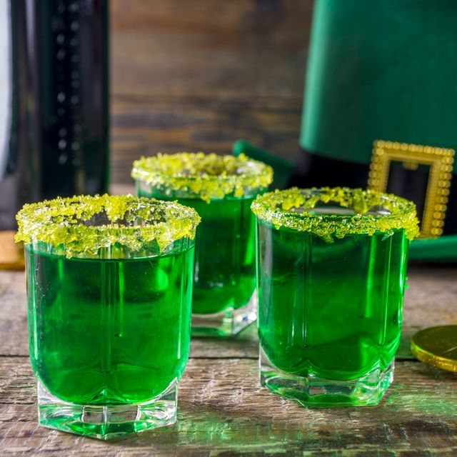 drinks for st patricks day party green cocktail in a shot glass with gold decor