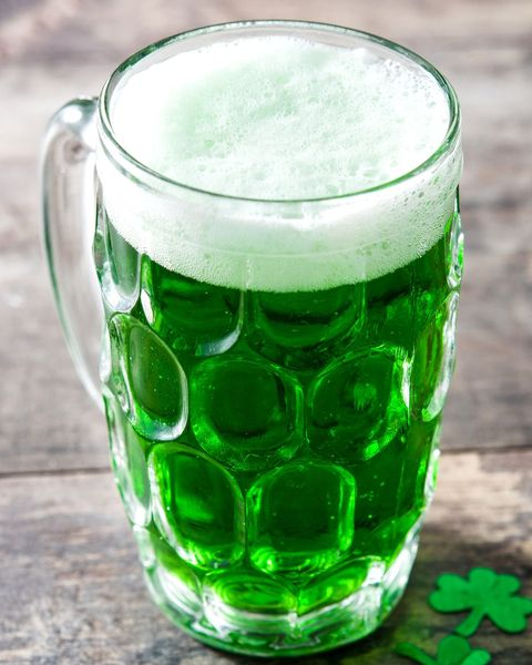 green beer in glass beer mug with st pattys decoration