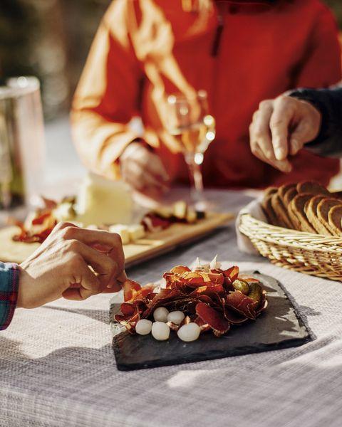 verdienter walliser teller mit weisswein im restaurant fafleralp im loetschentalwell deserved valais plate with white wine in the fafleralp restaurant in loetschental