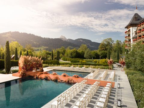 floating wedding ceremony on the pool of the hotel the alpina in gstaad