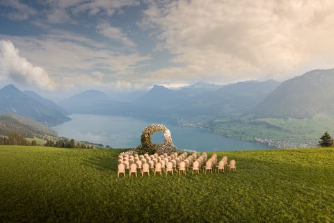 wedding ceremony outdoor and wedding arch at villa honegg lake lucerne