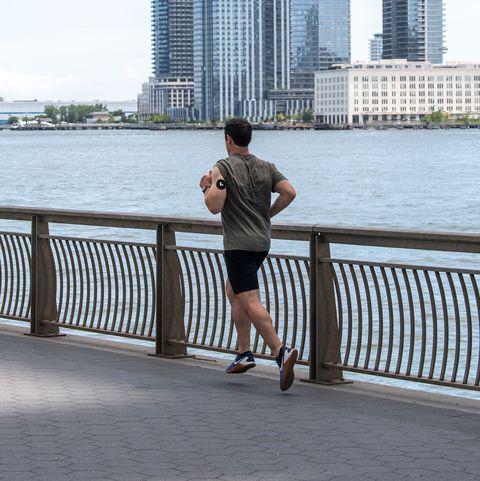 man running along waterfront