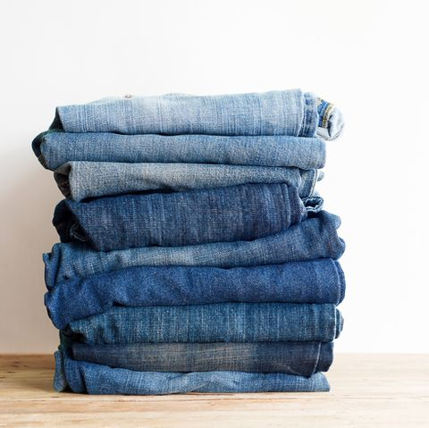 stack of blue jeans.