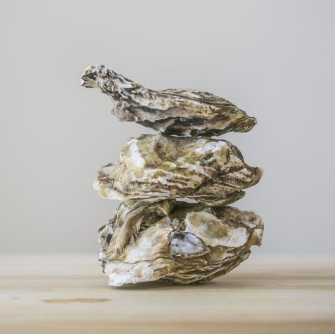 Stack of oyster on wooden plate
