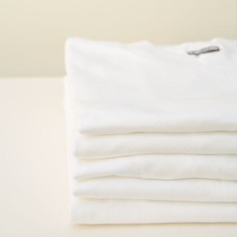 Stack of white t-shirts