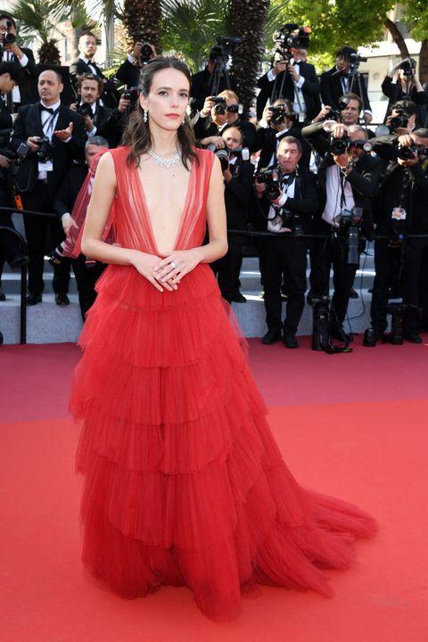 Red carpet, Fashion model, Carpet, Dress, Clothing, Flooring, Gown, Premiere, Haute couture, Fashion,