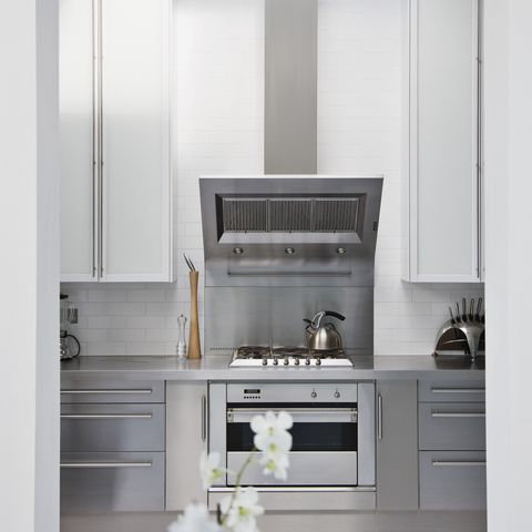 stainless steel stove in modern white kitchen - Kitchen Stove