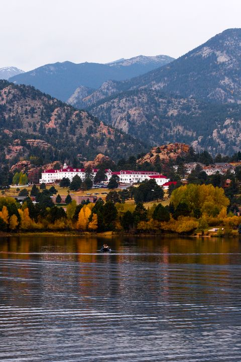 the stanley hotel surrounded by autumn trees