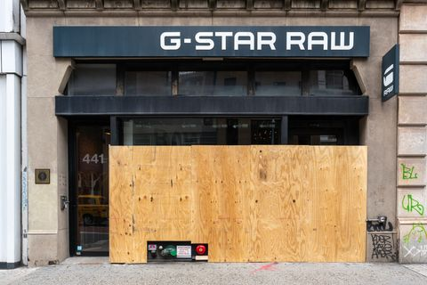 luxury stores in new york's soho neighborhood closed and boarded up
