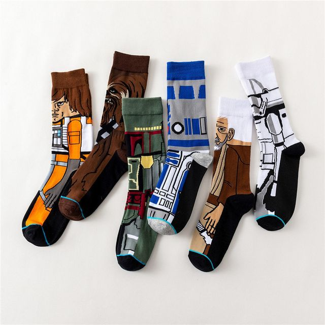 socks laying on white surface with star wars figures on them