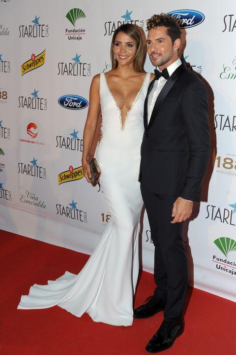 Carpet, Red carpet, Clothing, Dress, Formal wear, Shoulder, Suit, Hairstyle, Flooring, Premiere,