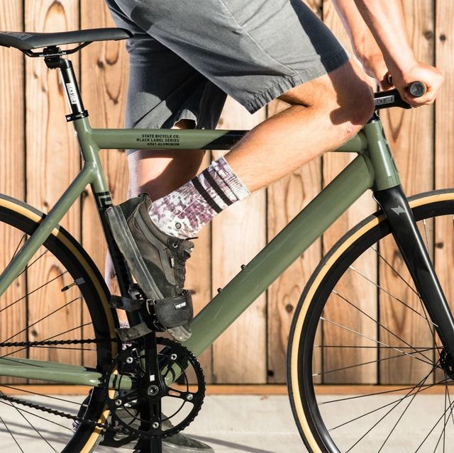 person riding state bicycle co fixed gear bike