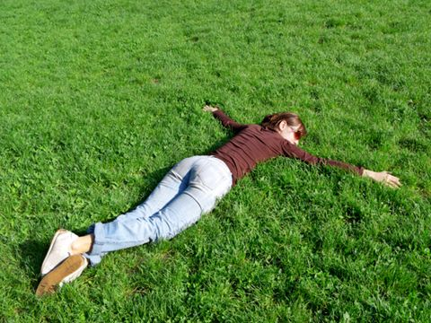 lie face down in grass