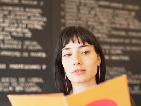 Woman holding menu