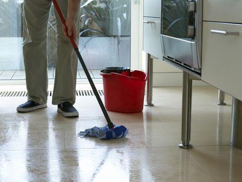 Man mopping kitchen floor