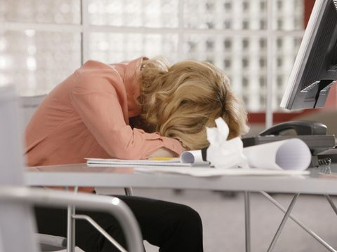 Woman asleep at desk