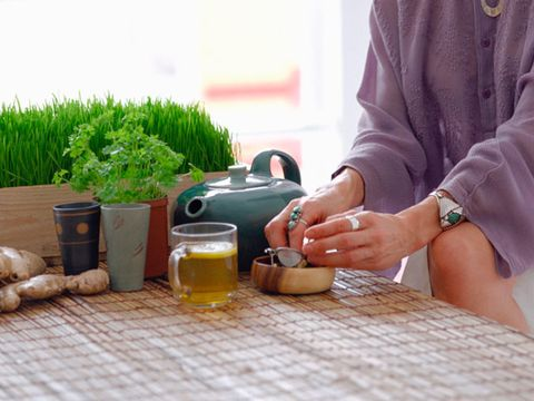 herbal remedies for pain; woman using herbs