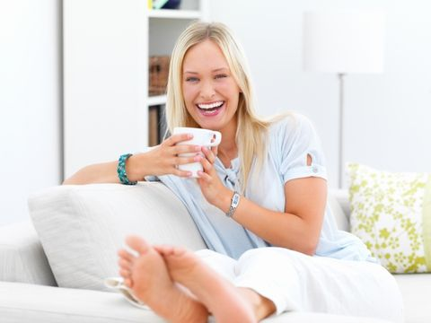 Smile, Finger, Comfort, Hand, Sitting, Room, Fashion accessory, Tooth, Eyelash, Couch,