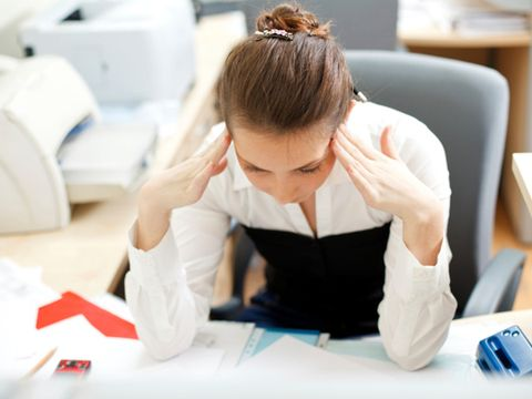 stressed woman at work desk