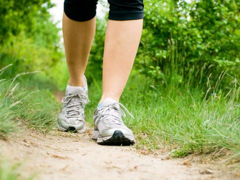 getting outside can reduce cortisol levels; woman walking outside