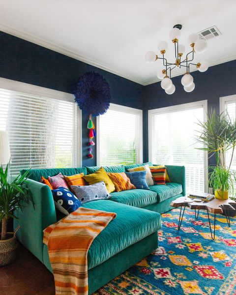 Room, Furniture, Interior design, Bedroom, Property, Turquoise, Green, Living room, Bed sheet, Wall,