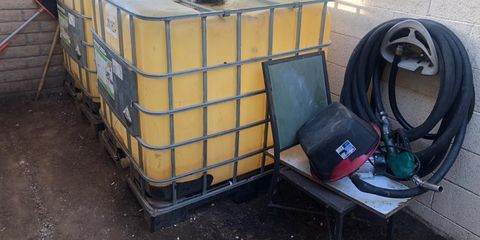 Transport, Waste container, Architecture, Vehicle, Gas, Recycling bin, Asphalt, Metal,