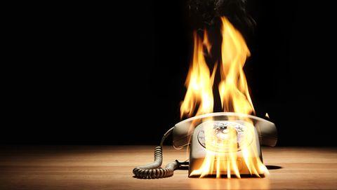 stationary telephone on fire