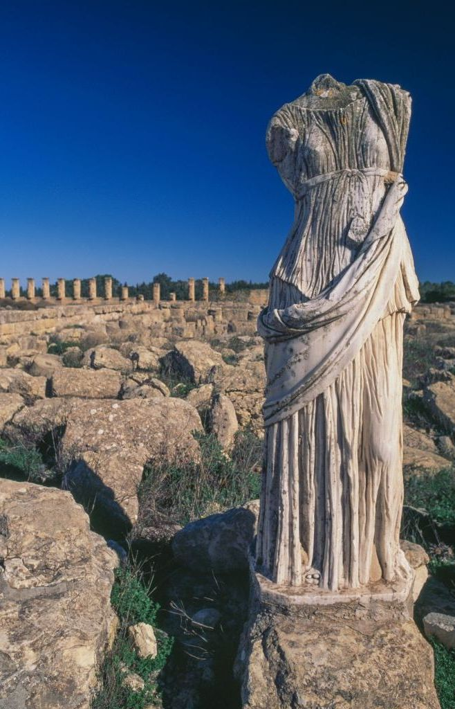 Female figure and ruins of houses, Cyrene