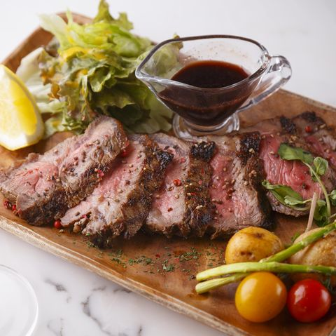 Steak , grilled beef with vegetables on the wood plate
