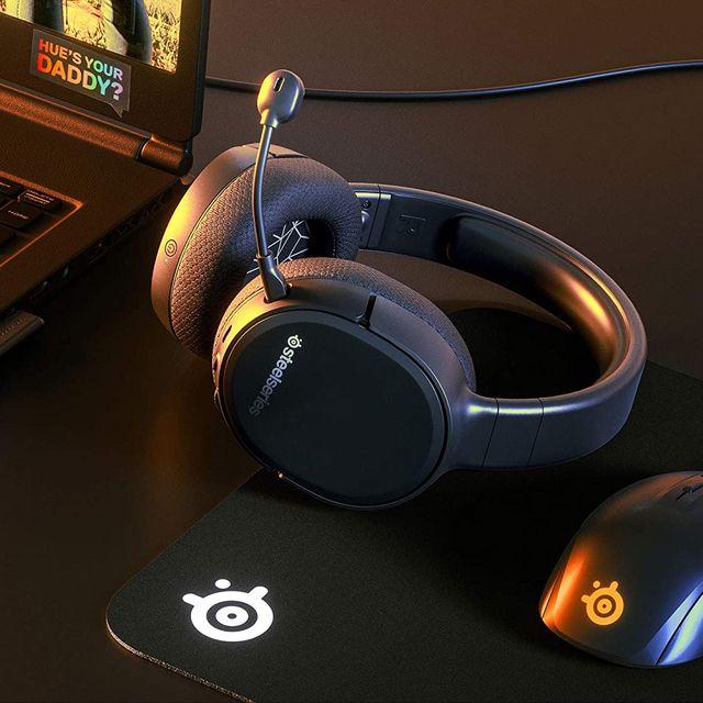 steelseries arctis 1 gaming headset next to laptop