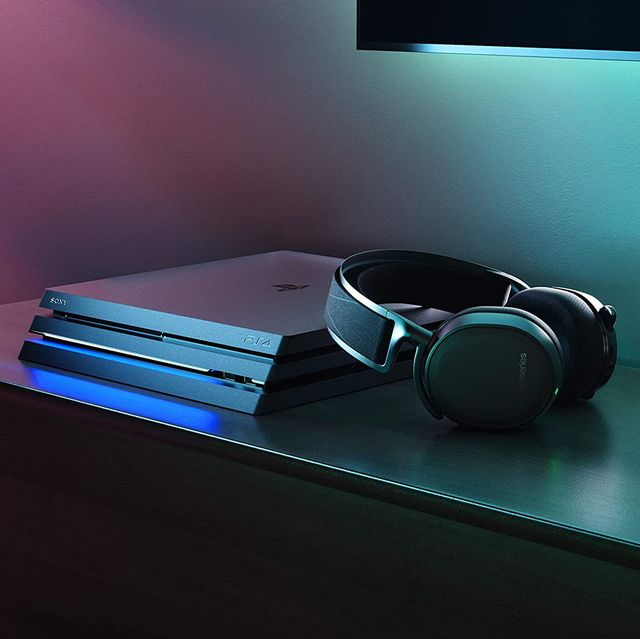 steelseries arctis 7 gaming headset next to ps4