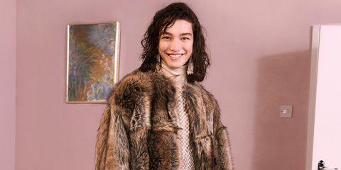 Clothing, Fur, Fur clothing, Fashion model, Fashion, Outerwear, Textile, Coat, Haute couture, Long hair,