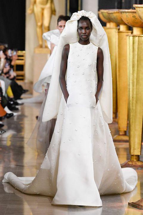 Gown, Dress, Wedding dress, Clothing, Fashion, Fashion model, Photograph, Bridal clothing, Haute couture, Bride,