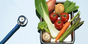Stethoscope beside tray of fresh vegetables