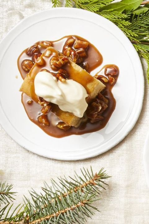 christmas foods   a pair of sticky toffee puddings on white plates