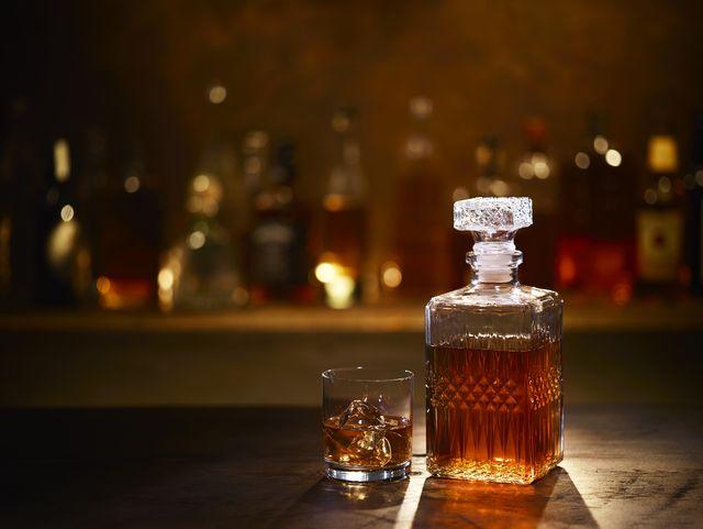 still life of bourbon whiskey on bar