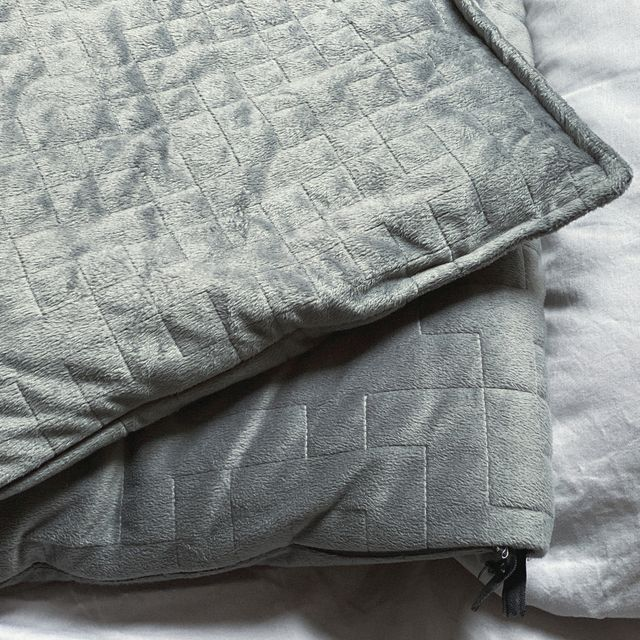 still life of gray, weighted, blanket in bedroom