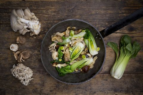 Stir-fry with Chinese cabbage, maitake, oyster and shitake mushrooms in pan